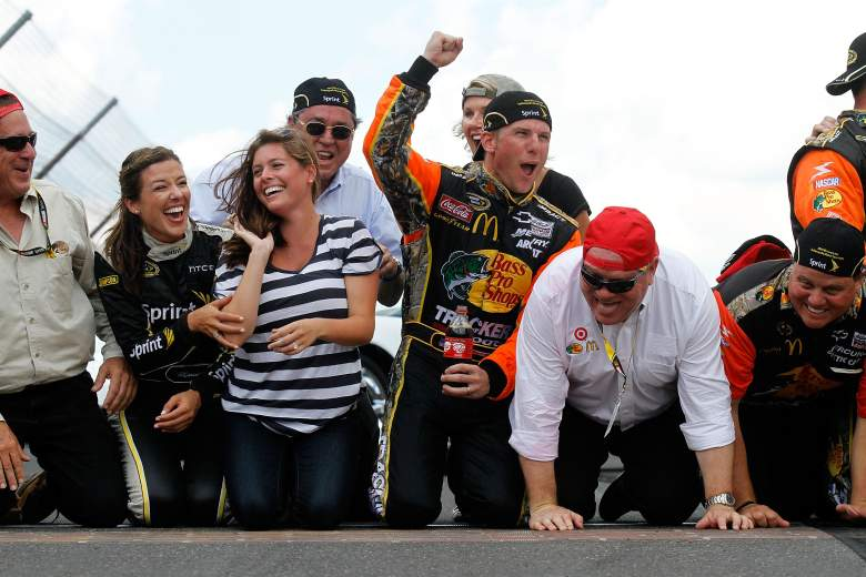 Jamie McMurray celebrating a July 2010 victory with his wife Christy and team members. (Getty)