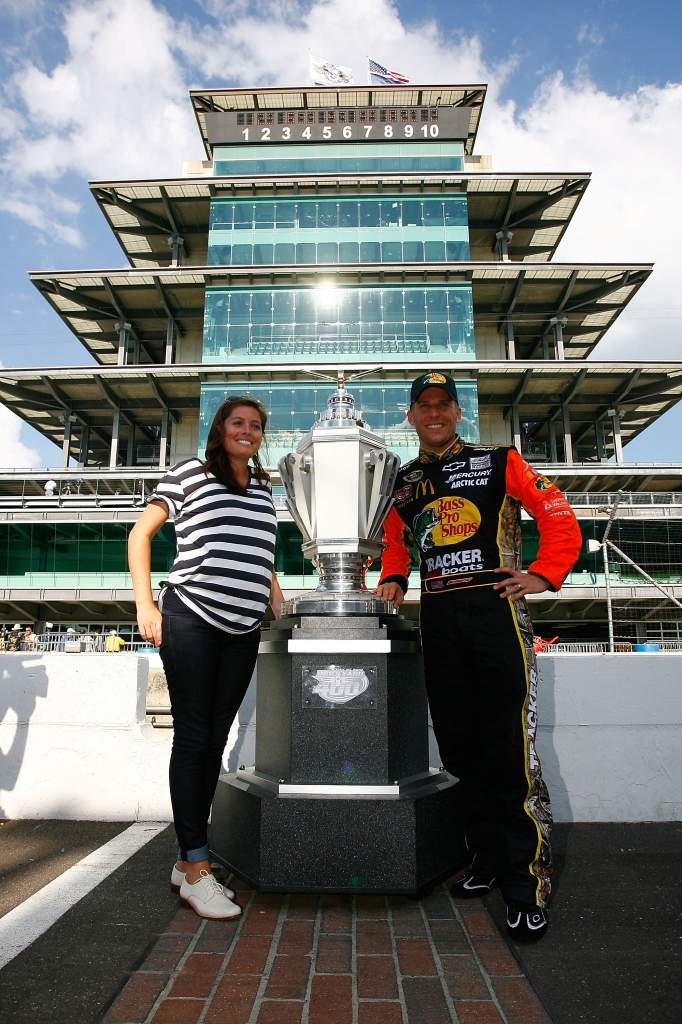 McMurray and his wife Christy pose with the Brickyard 400 Trophy at Indianapolis Motor Speedway. (Getty)