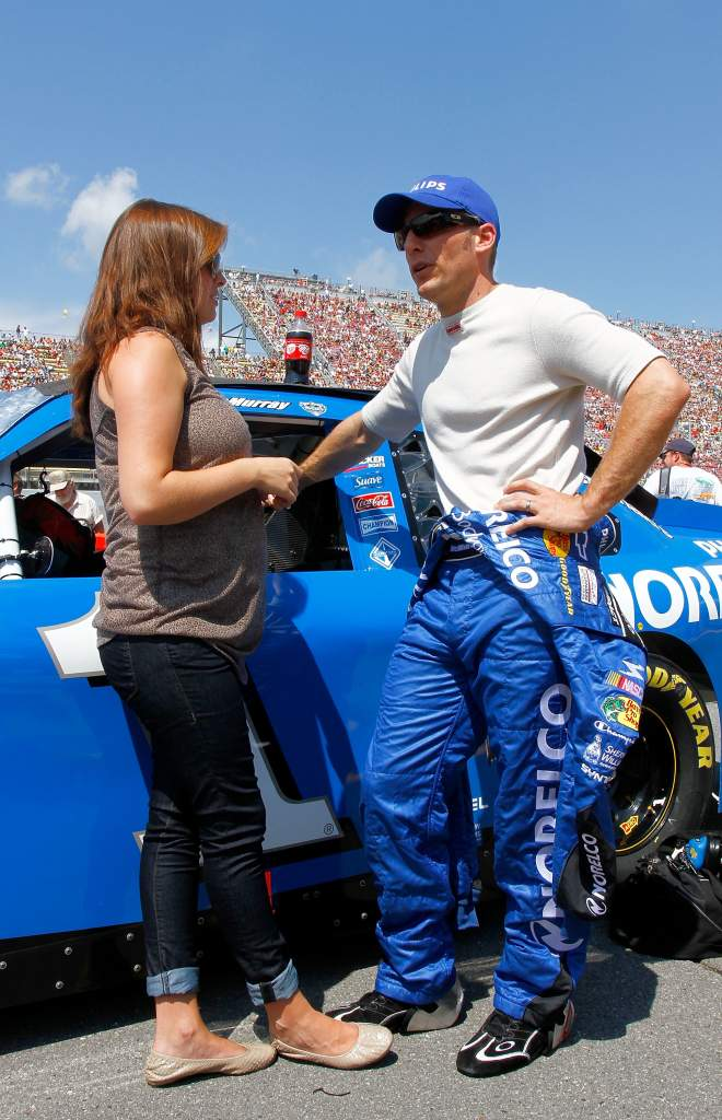 Jamie McMurray talks to his wife Christy before the CARFAX 400 at Michigan International Speedway in August 2010. (Getty)