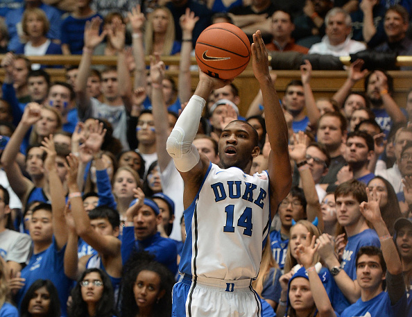 Duke guard Rasheed Sulaimon (14) shoots one of his first-half three-pointers against Pittsburgh on Monday, Jan. 19, 2015, at Cameron Indoor Stadium in Durham, N.C. (Getty)