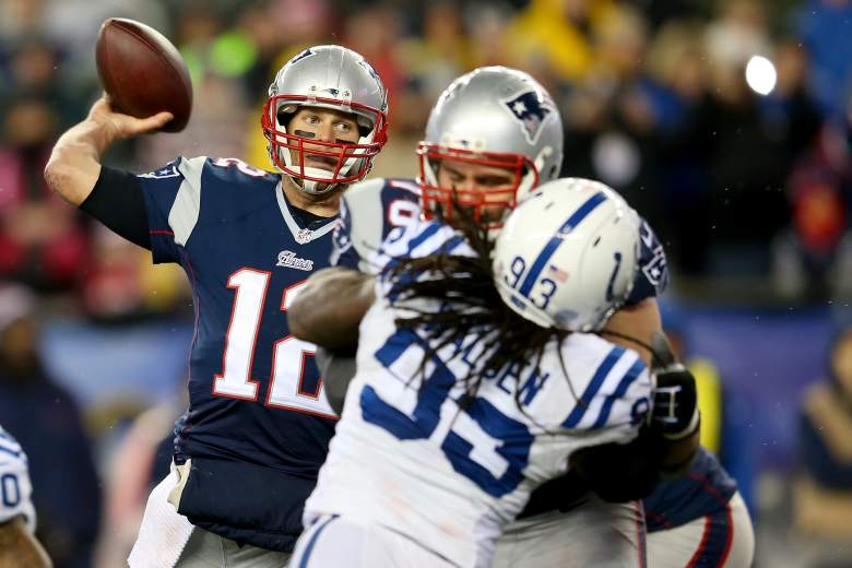 Patriots quarterback Tom Brady attempts a pass during the AFC Championship Game against the Colts. (Getty)