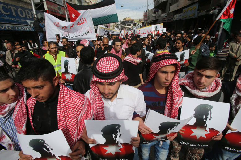 Thousands of Jordanians participate in a mass demonstration after Friday prayers near Al Hussein Mosque to express their solidarity with the pilot murdered by ISIS. (Getty)