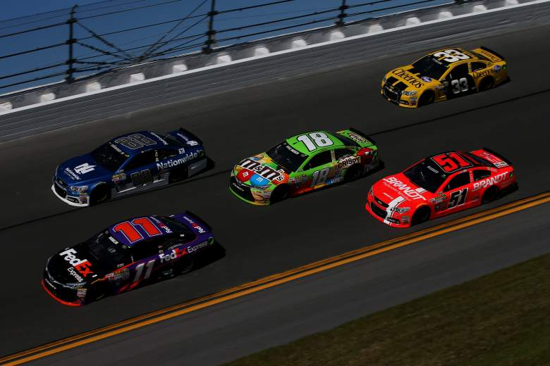 Denny Hamlin (11) and Dale Earnhardt Jr. (88) lead a pack of cars during Daytona 500 practice. (Getty)