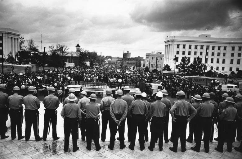 A line of policemen on duty during a black voting rights march in Montgomery, Alabama. Dr Martin Luther King led the march from Selma, Alabama, to the state capital in Montgomery.  (William Lovelace/Express/Getty Images)