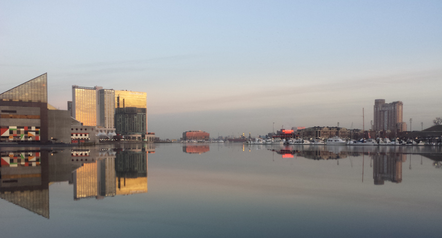 The skyline of Baltimore, Maryland, is reflected in a still and icy Inner Harbor on January 31, 2014. (Getty)