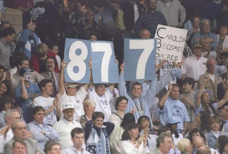 North Carolina fans celebrate Dean Smith's record-breaking 877th career win on March 15, 1997 against Colorado. (Getty)