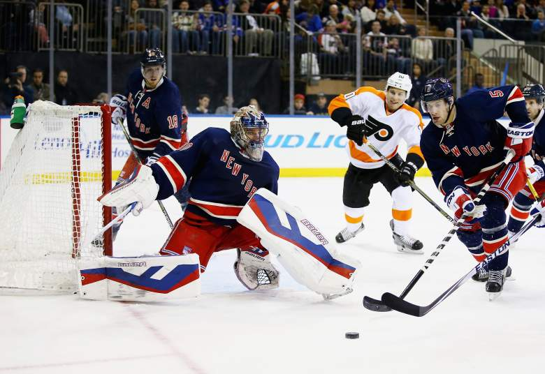 New York Rangers goalie Henrik Lundqvist makes a save against the Philadelphia Flyers earlier this season. Lundqvist has a neck injury that will keep him out of Saturday's game. (Getty)