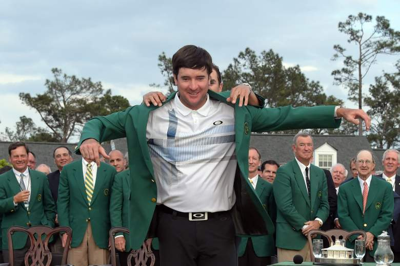 Bubba Watson puts on the ceremonial green jacket after winning the 2014 Masters Tournament. (Getty)