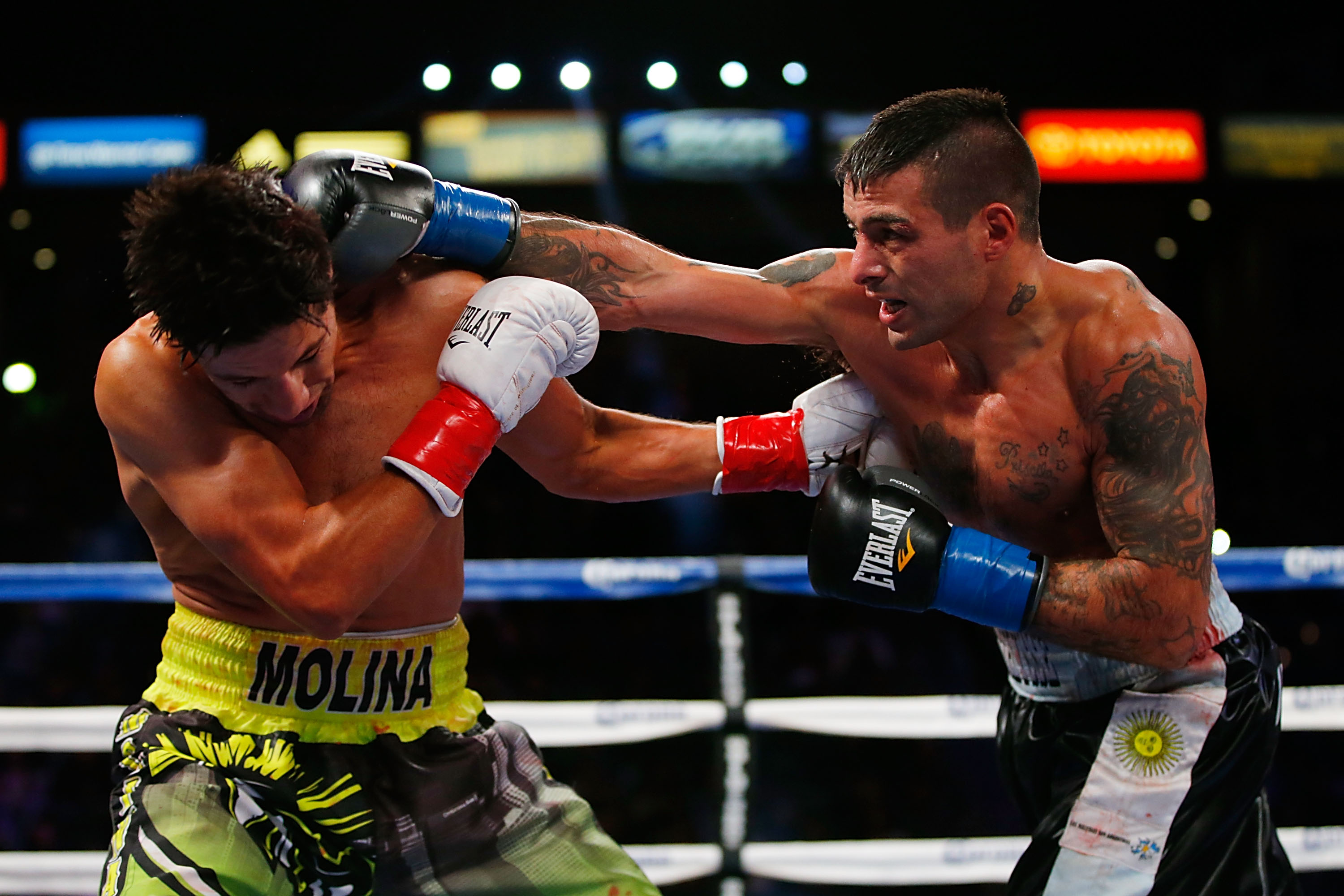 Lucas Matthysse (R) punches John Molina (Getty)