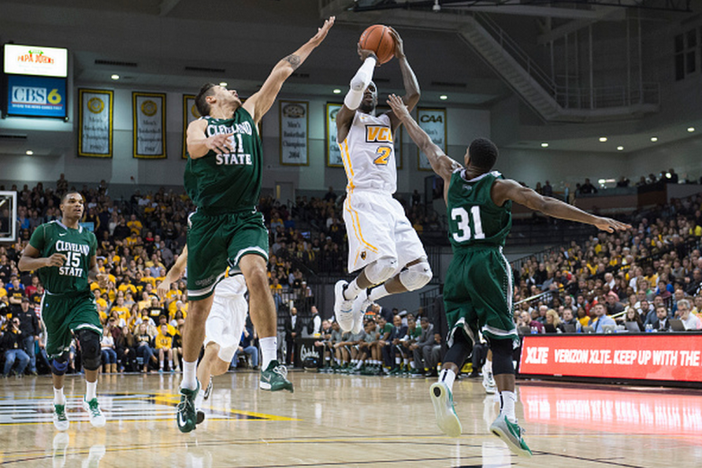 Briante Weber of the Virginia Commonwealth Rams shoots as Vinny Zollo  and Charlie Lee of the Cleveland State Vikings defends during the second half at the Siegel Center on December 29, 2014 in Richmond,  Virginia. (Getty)