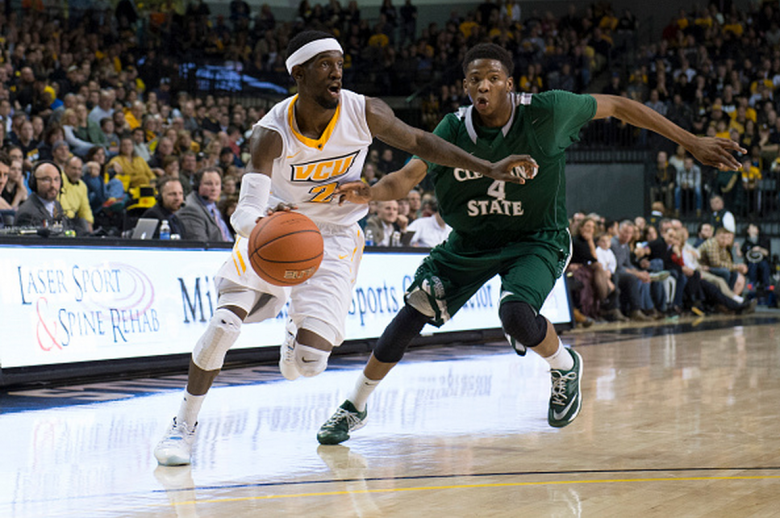 Briante Weber of the Virginia Commonwealth Rams drives to the basket as Kenny Carpenter of the Cleveland State Vikings defends  during the second half at the Siegel Center on December 29, 2014 in Richmond,  Virginia. (Getty)