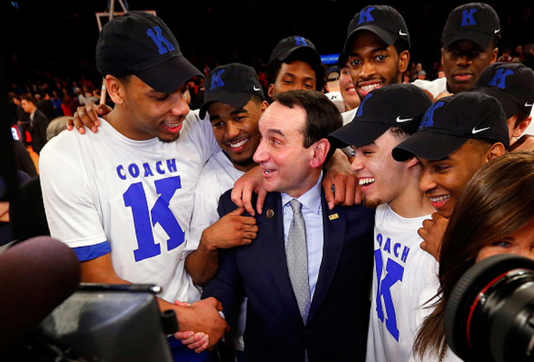 Head coach Mike Krzyzewski of the Duke Blue Devils celebrates with his players after defeating the St. John's Red Storm earning his 1,000th career victory on January 25 2015 at Madison Square Garden in New York City. Duke defeated St John's 77-68. (Getty)