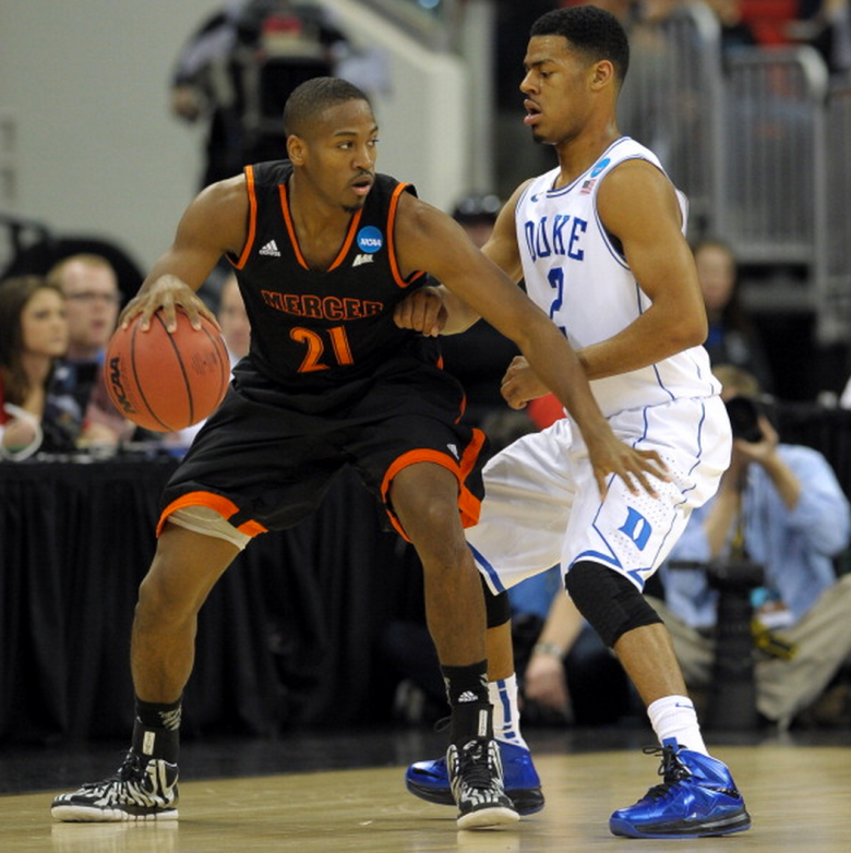 Langston Hall #21 of the Mercer Bears dribbles against Quinn Cook #2 of the Duke Blue Devils during the Second Round of the 2014 NCAA Basketball Tournament at PNC Arena on March 21, 2014 in Raleigh, North Carolina. Mercer defeated Duke 78-71. (Getty)