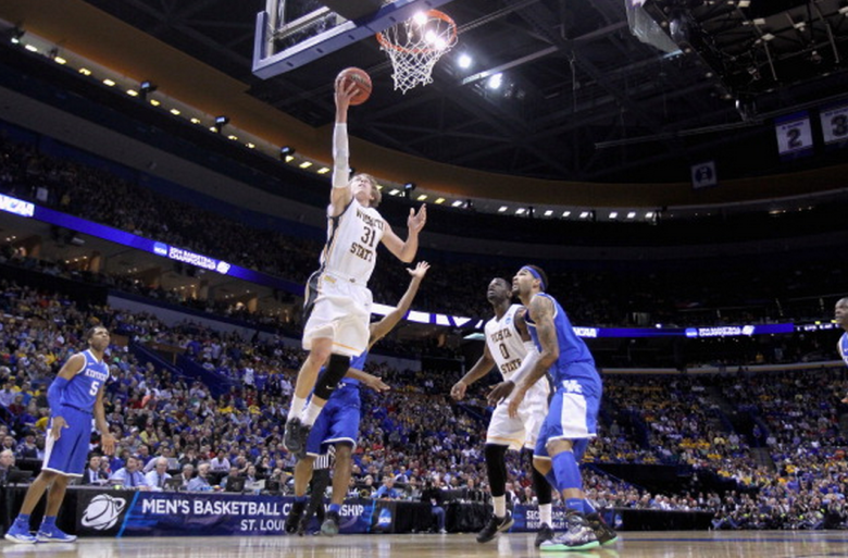 Ron Baker #31 of the Wichita State Shockers shoots the ball against the Kentucky Wildcats during the third round of the 2014 NCAA Men's Basketball Tournament at Scottrade Center on March 23, 2014 in St Louis, Missouri. (Getty)