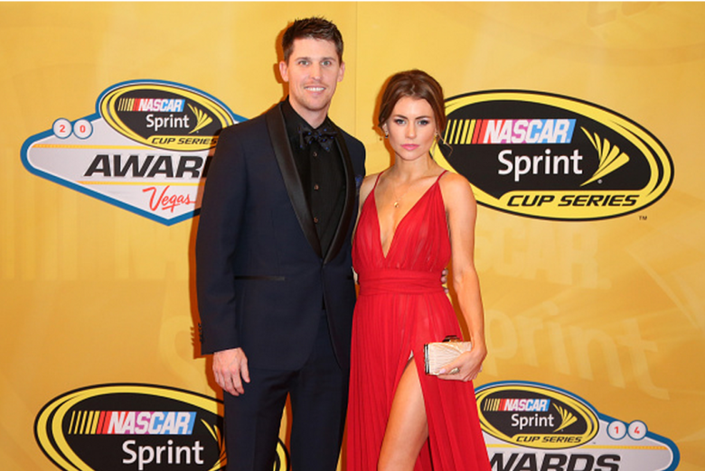 Denny Hamlin and his girlfriend Jordan Fish arrive on the red carpet prior to the 2014 NASCAR Sprint Cup Series Awards at Wynn Las Vegas on December 5, 2014 in Las Vegas, Nevada. (Getty)