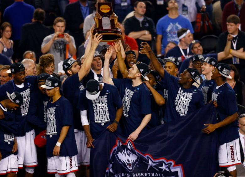 The Connecticut Huskies celebrate with the trophy after defeating the Kentucky Wildcats 60-54 in the NCAA Men's Final Four Championship at AT&T Stadium on April 7, 2014 in Arlington, Texas. (Getty)