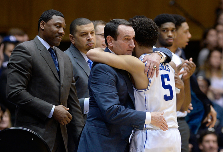 Head coach Mike Krzyzewski embraces Tyus Jones #5 of the Duke Blue Devils during the final seconds of their win against the Clemson Tigers at Cameron Indoor Stadium on February 21, 2015 in Durham, North Carolina. Duke won 78-56. (Getty)