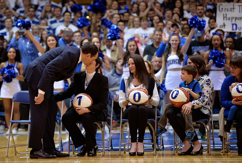 Head coach Mike Krzyzewski of the Duke Blue Devils kisses his wife Mickie during a ceremony celebrating his 1,000th career victory following a game against the Georgia Tech Yellow Jackets at Cameron Indoor Stadium on February 4, 2015 in Durham, North Carolina. (Getty)