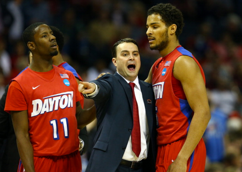 Head coach Archie Miller speaks with Devin Oliver #5 of the Dayton Flyers during a regional semifinal of the 2014 NCAA Men's Basketball Tournament against the Stanford Cardinal at the FedExForum on March 27, 2014 in Memphis, Tennessee. (Getty)