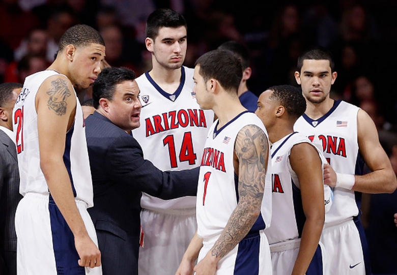 Head coach Sean Miller of the Arizona Wildcats talks to his team during a break from the college basketball game against the USC Trojans at McKale Center on February 19, 2015 in Tucson, Arizona. (Getty)