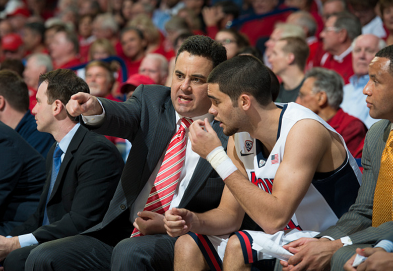 Head coach Sean Miller of the Arizona Wildcats instructs guard Elliott Pitts #24 of the Arizona Wildcats during their game against the USC Trojans at McKale Memorial Center on February 19, 2015 in Tucson, Arizona. (Getty)