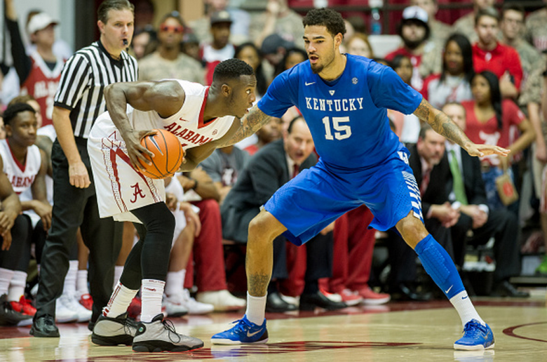 Shannon Hale (11) of the Alabama Crimson Tide looks to maneuver by Willie Cauley-Stein (15) of the Kentucky Wildcats during the game at Coleman Coliseum on January 17, 2015 in Tuscaloosa, Alabama. The Kentucky Wildcats defeated the Alabama Crimson Tide 70-48. (Getty)