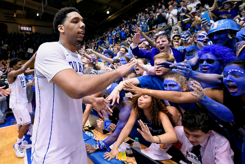 Jahlil Okafor #15 of the Duke Blue Devils celebrates with fans after a win against the North Carolina Tar Heels at Cameron Indoor Stadium on February 18, 2015 in Durham, North Carolina. Duke won 92-90 in overtime. (Getty)