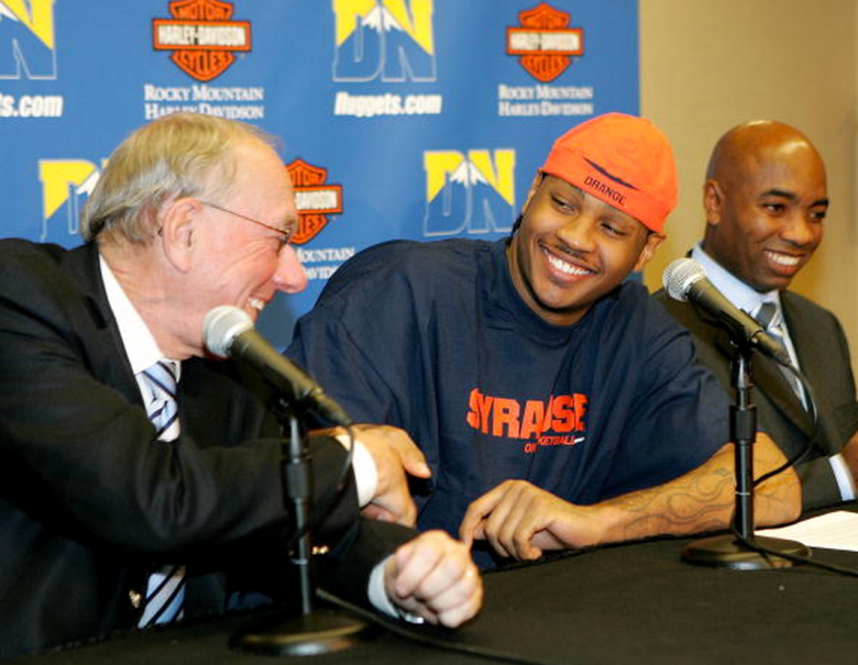 Syracuse Head coach Jim Boeheim (L) and Athletic Director, Daryl Gross (R) sit with Carmelo Anthony of the Denver Nuggets as he announces a 3 Million Dollar donation to the University of Syracuse for a new Basketball facility on November 7, 2006 at the Pepsi Center in Denver, Colorado. (Getty)