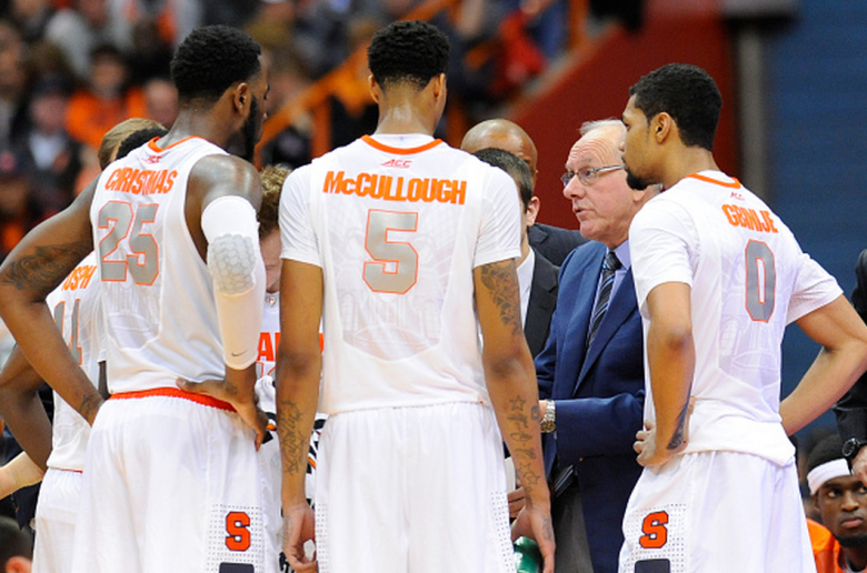 Head coach Jim Boeheim of the Syracuse Orange speaks with his team during a time out against the St. John's Red Storm in the second half of the game at the Carrier Dome on December 6, 2014 in Syracuse, New York. St. John's defeated Syracuse 69-57. (Getty)