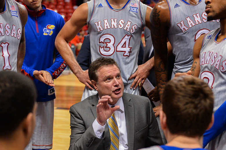 Head coach Bill Self of the Kansas Jayhawks talks with his team during a timeout against the Texas Tech Red Raiders on February 10, 2015 at United Supermarkets Arena in Lubbock, Texas. Kansas defeated Texas Tech 73-51. (Getty)