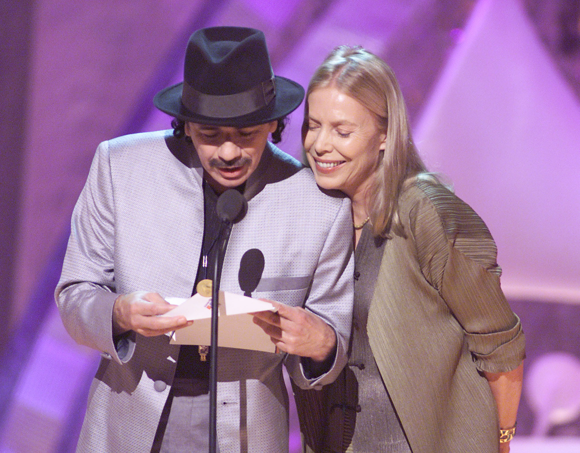 Carlos Santana and Joni Mitchell at the 43rd Annual Grammy Awards broadcast at Staples Center in Los Angeles, CA on February 21, 2001. (Getty)