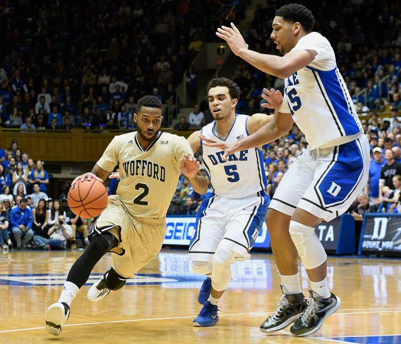 Tyus Jones #5 and Jahlil Okafor #15 of the Duke Blue Devils defend a drive by Karl Cochran #2 of the Wofford Terriers during their game at Cameron Indoor Stadium on December 31, 2014. (Getty)