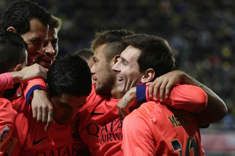 Lionel Messi, right, celebrates with teammates during Barcelona's match with Villareal Wednesday. (Getty)