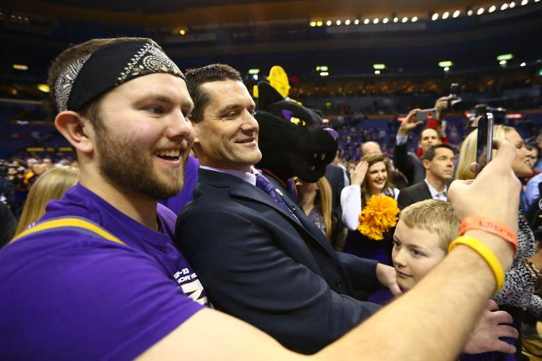 Coach Ben Jacobson poses for a selfie with a fan. (Getty)