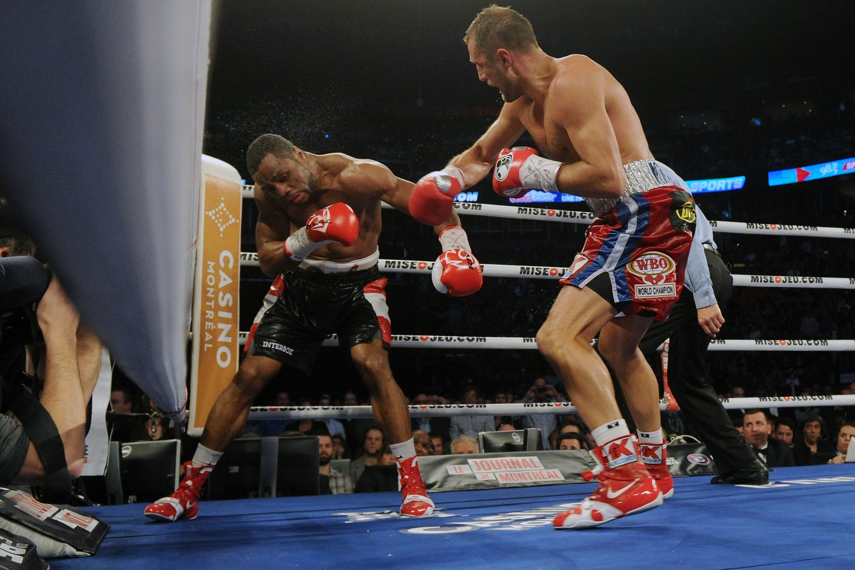 Jean Pascal takes a right hand to the head from Sergey Kovalev. (Getty)
