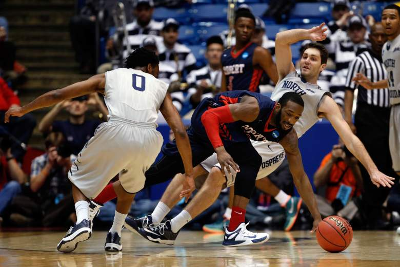 Lucky Jones of Robert Morris collides with Beau Beech of North Florida during the first round of the  NCAA Tournament in Dayton, Ohio.