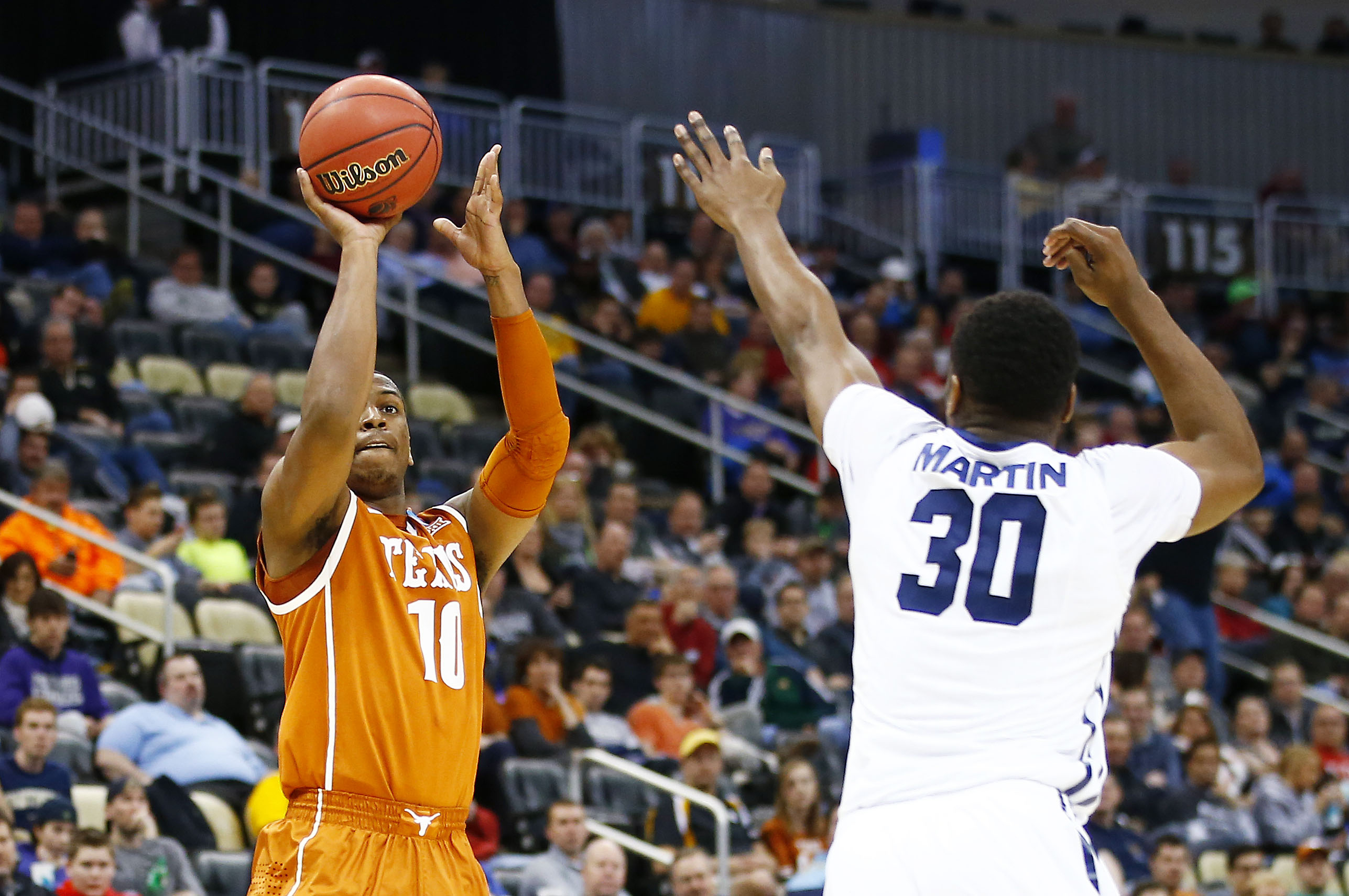 Jonathan Holmes takes a shot for Texas against Butler. (Getty)