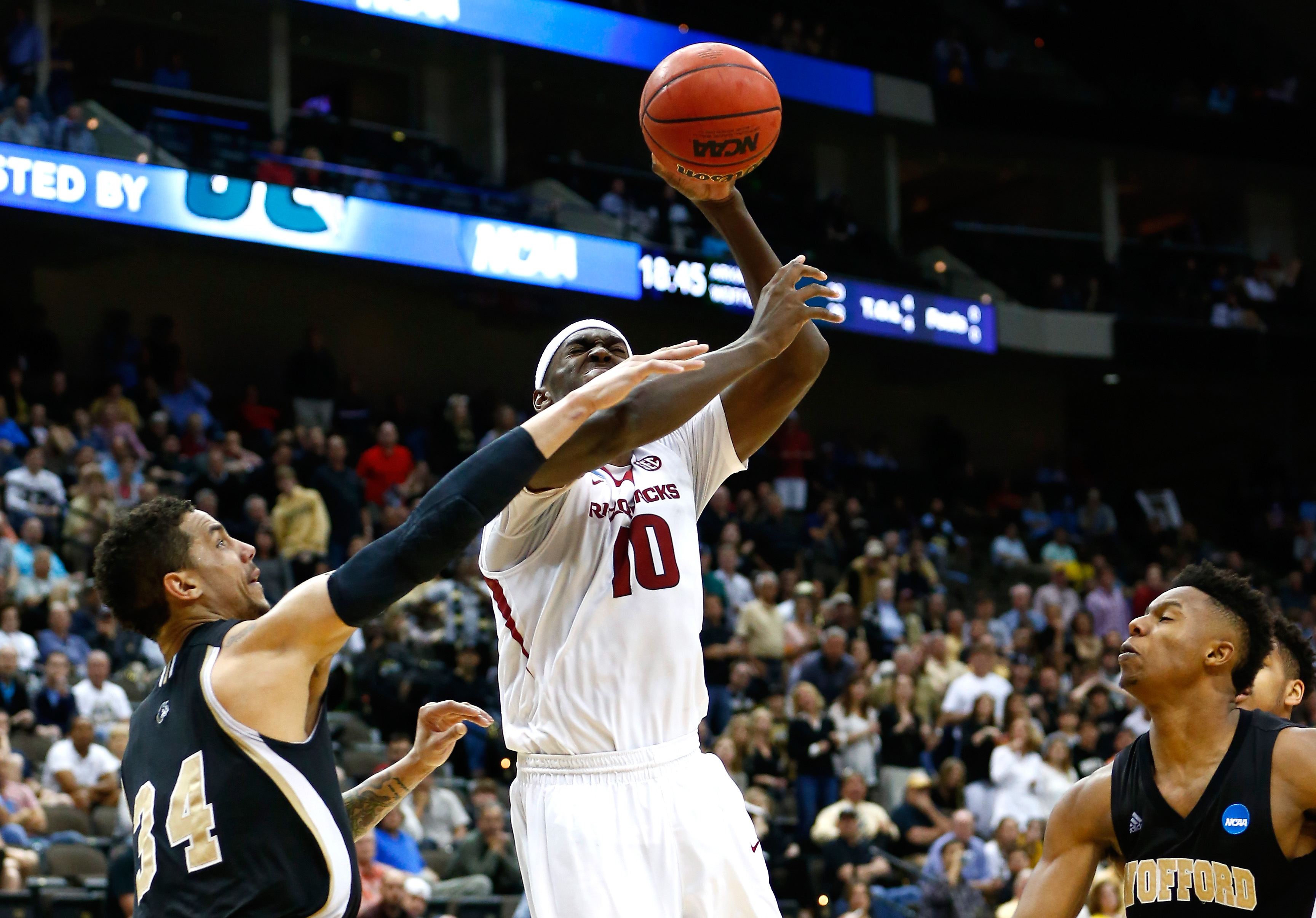 Lee Skinner #34 of the Wofford Terriers hits Bobby Portis #10 of the Arkansas Razorbacks during the second round of the 2015 NCAA Men's Basketball Tournament. (Getty)