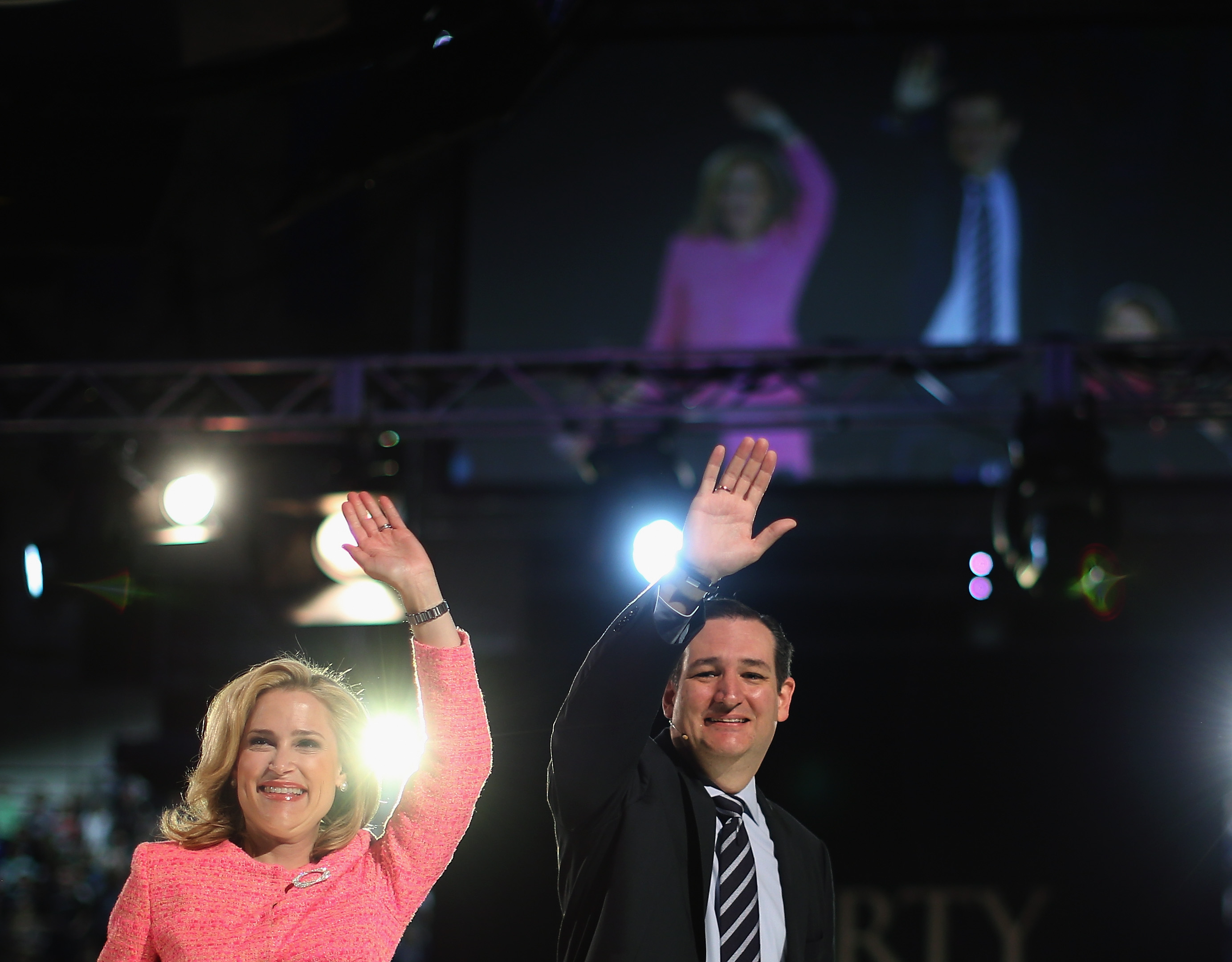 Sen. Ted Cruz (R-TX) (R) and his wife Heidi Cruz wave to the crowd at Liberty University. (Getty)
