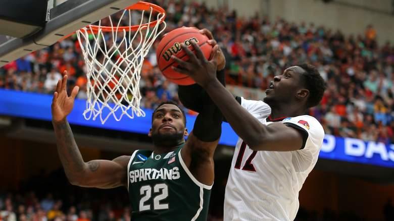 Branden Dawson of Michigan State  blocks the shot of Louisville's Mangok Mathiang Sunday. (Getty)