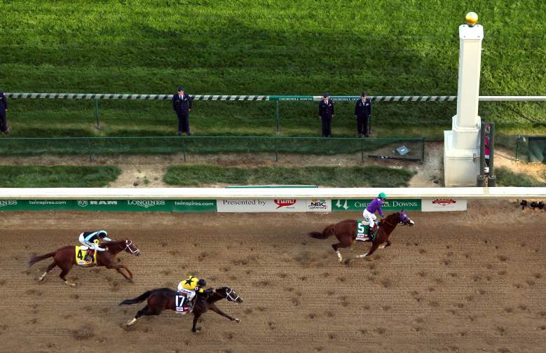 California Chrome crosses the finish line to win the 2014 Kentucky Derby. (Getty)