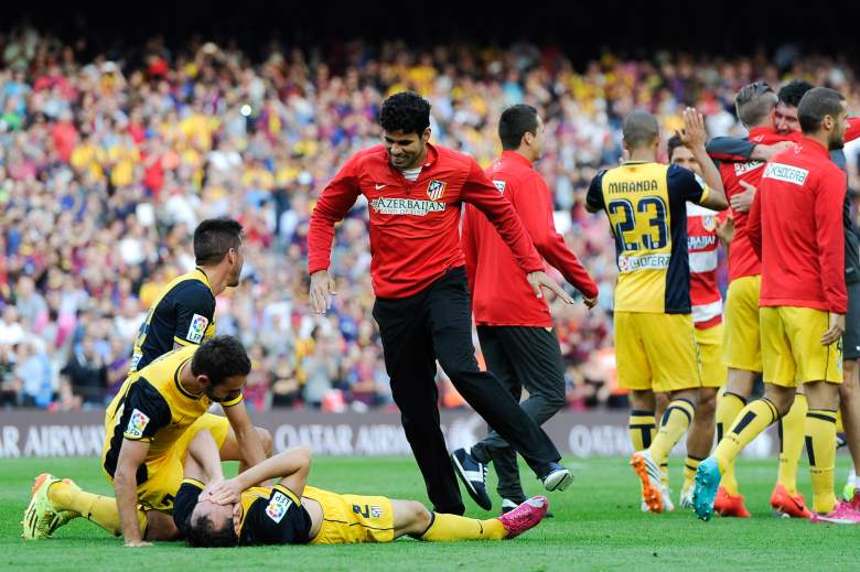 Diego Costa celebrates with his teammates after winning the Spanish League last May.