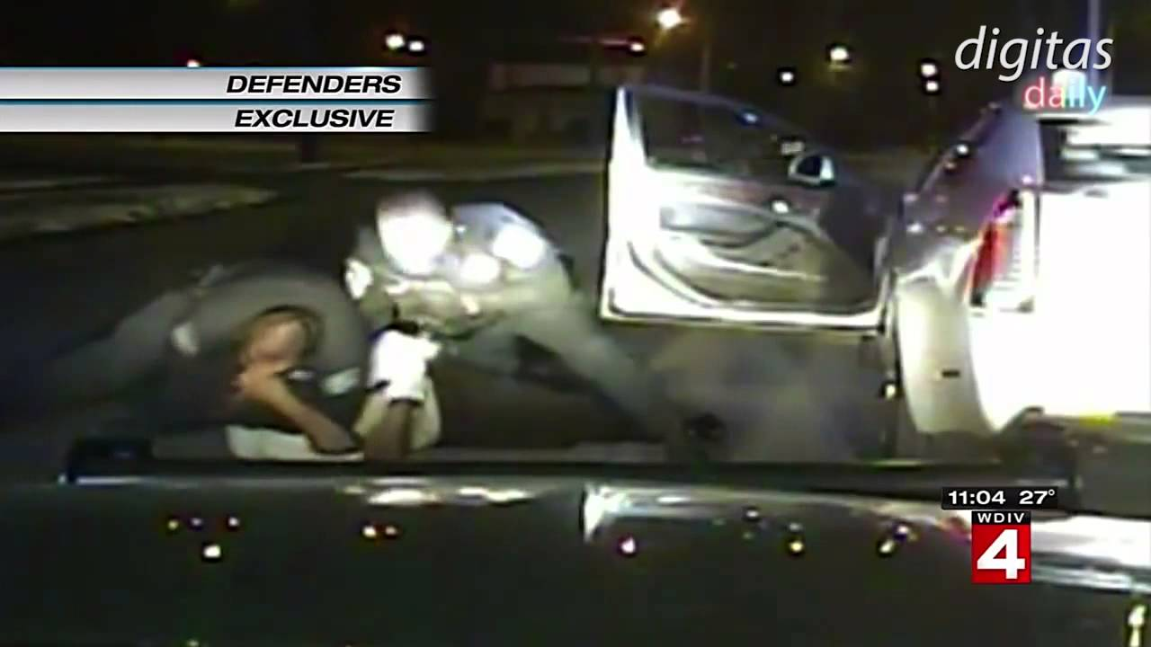 A YouTube screenshot shows the arrest of Floyd Dent, which has led to accusations of police brutality.