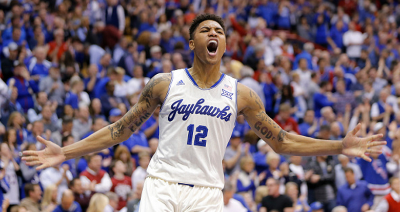 Kansas guard Kelly Oubre Jr. celebrates after the Jayhawks defeated Oklahoma 85-78 on Monday, Jan. 19, 2015, at Allen Fieldhouse in Lawrence, Kan. Kansas squandered a 19-point halftime lead and had to rally in the final minutes to win the game. (Getty)
