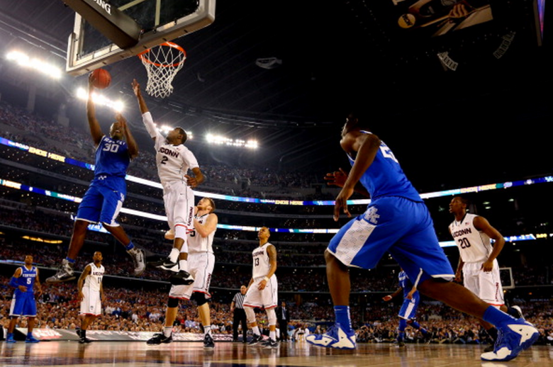 Julius Randle #30 of the Kentucky Wildcats goes to the basket as DeAndre Daniels #2 of the Connecticut Huskies defends during the NCAA Men's Final Four Championship at AT&T Stadium on April 7, 2014 in Arlington, Texas. (Getty)