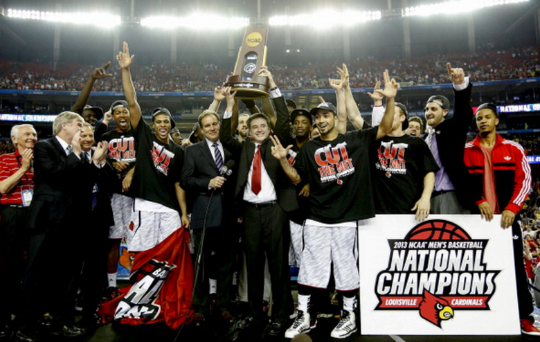 Louisville Cardinals head coach Rick Pitino celebrates with his team after defeating Michigan, 82-76, and winning the NCAA Men's Basketball Championship at the Georgia Dome in Atlanta, Georgia, Monday, April 8, 2013. (Getty)
