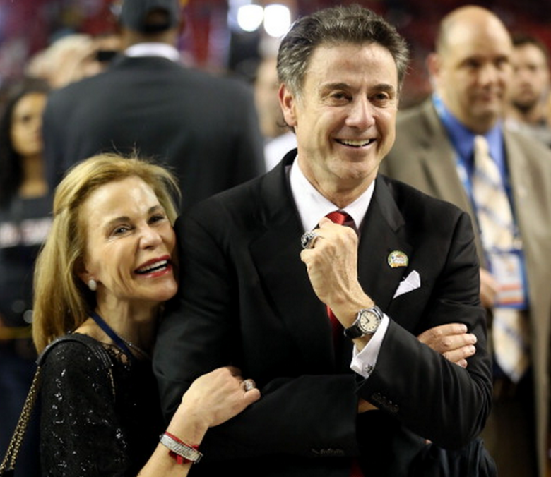 Head coach Rick Pitino of the Louisville Cardinals and his wife Joanne celebrate after they won 82-76 against the Michigan Wolverines during the 2013 NCAA Men's Final Four Championship at the Georgia Dome on April 8, 2013 in Atlanta, Georgia. (Getty)
