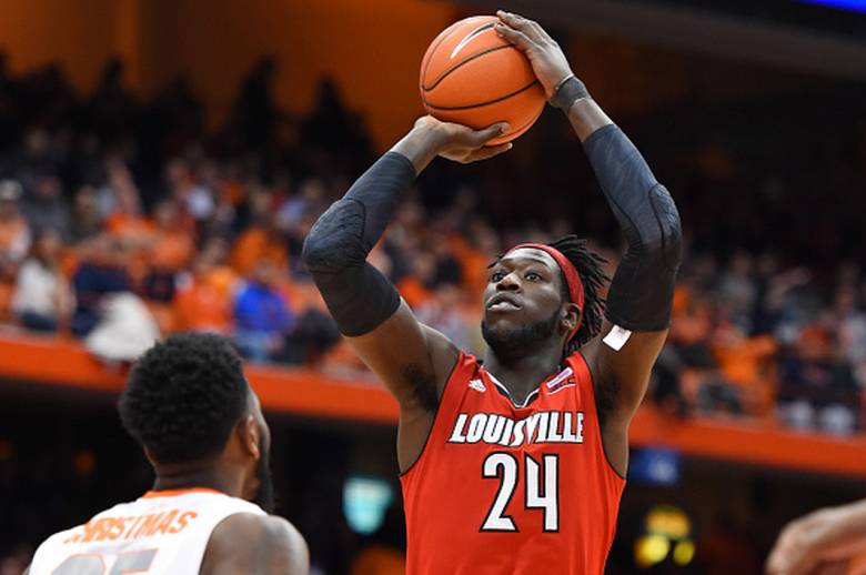 Montrezl Harrell #24 of the Louisville Cardinals shoots the ball over Rakeem Christmas #25 of the Syracuse Orange during the first half at the Carrier Dome on February 18, 2015 in Syracuse, New York. Syracuse defeated Louisville 69-59. (Getty)
