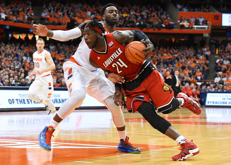 Montrezl Harrell #24 of the Louisville Cardinals drives to the basket around Rakeem Christmas #25 of the Syracuse Orange during the first half at the Carrier Dome on February 18, 2015 in Syracuse, New York. Syracuse defeated Louisville 69-59. (Getty)