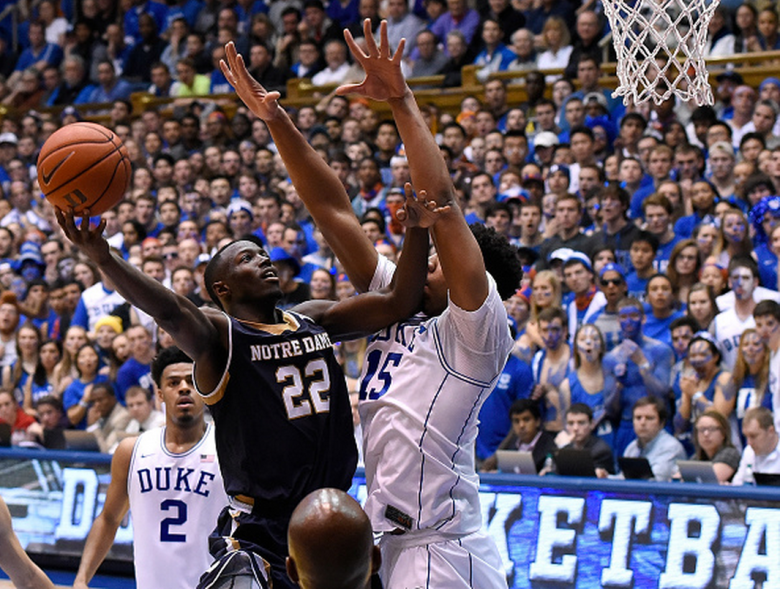 Jerian Grant #22 of the Notre Dame Fighting Irish drives against Jahlil Okafor #15 of the Duke Blue Devils during their game at Cameron Indoor Stadium on February 7, 2015 in Durham, North Carolina. Duke won 90-60. (Getty)